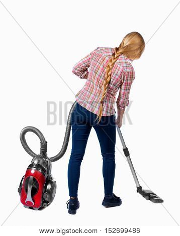 Rear view of a woman with a vacuum cleaner. She is busy cleaning. Rear view people collection.  backside view of person.  Isolated over white background. Long-haired blonde with a vacuum cleaner.