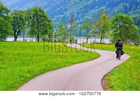 Bike rider cycling a bikeway along the Danube river in Austria Europe
