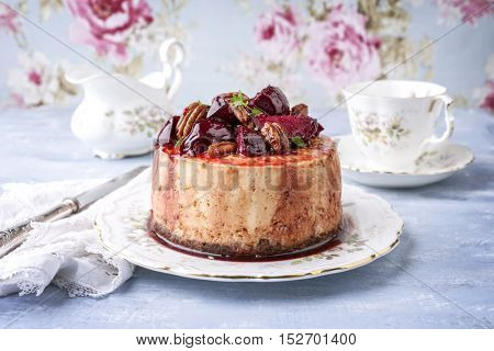 Cheesecake with Plum and Pecan Nut on Plate