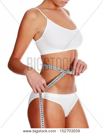 Slim woman with a tape measure, isolated on white background