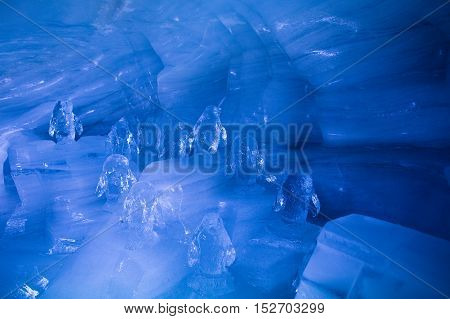 Penguin Sculpture In Ice Cave In Swiss Alps Glacier