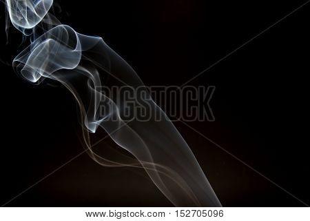 White smoke wave on a dark backgrounds