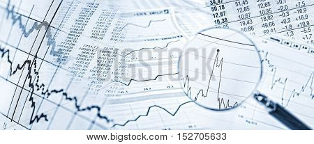 Stock quotes price charts and a magnifying glass with stock price in detail.