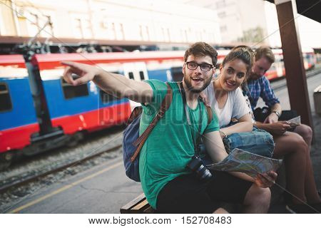 Traveling young tourist backpacker friends exploring Europe