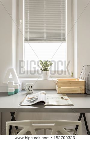 Functional home office with window desk and chair
