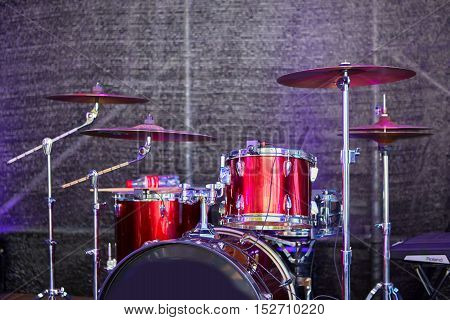 Modern drum set on stage prepared for playing