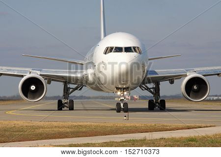 Borispol Ukraine - October 23 2011: Boeing 767 is taxiing along the taxiway to the runway