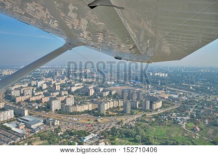 Kiev Ukraine - November 12 2010: Residential districts of Kiev Ukraine view from the board of a light airplane