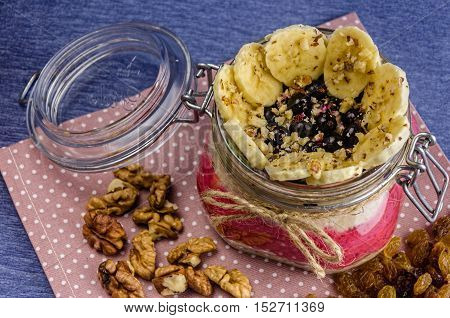 Oatmeal As A Smoothie With Banana Slices, Cranberries And Currants