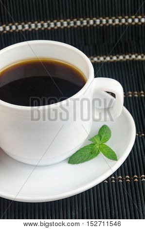 Fresh Cup Of Hot Black Coffee With Mint Leaves