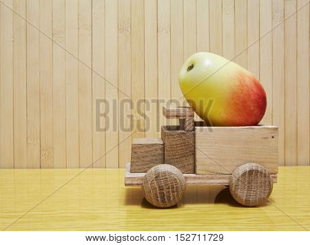 Toy Wooden Car With Yellow Apple