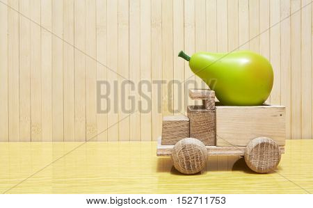 Toy Wooden Car With Green Pear