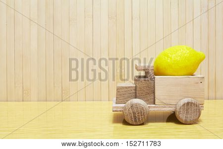 Toy Wooden Car With Yellow Lemon