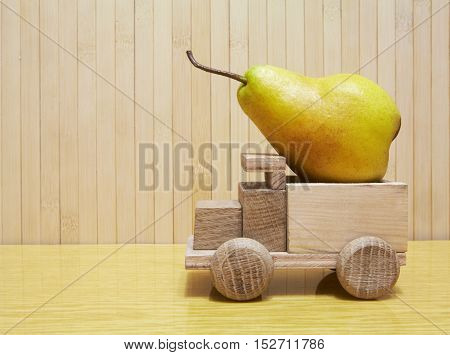 Toy Wooden Car With Yellow Pear