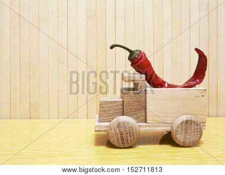 Toy Wooden Car With Red Pepper