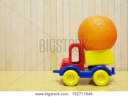Toy Plastic Car With Orange