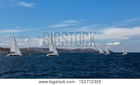 Luxury yachts at Sailing regatta. Yachting in the wind through the waves at the Sea.
