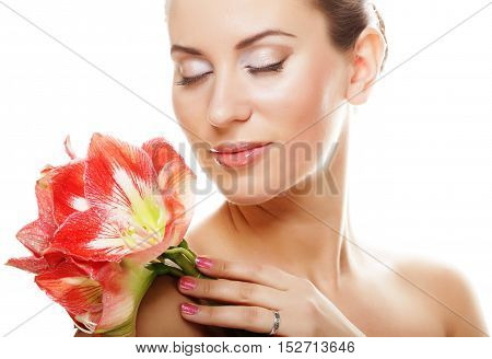 young beautiful woman with big pink flowers, isolated on white