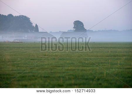 Meadow With Farm In Morning Mist. Geesteren. Gelderland. The Netherlands.