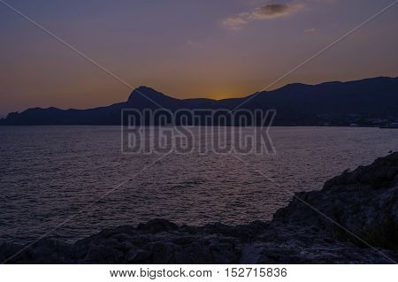 Evening landscape sunset over the Black Sea and Crimean Mountains