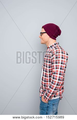 Side View Portrait Of Young Hipster Guy In Glasses And Violet Cap