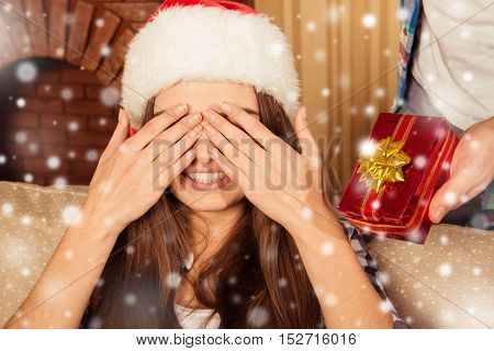 Smiling Girl With Closed Eyes Waiting For Christmas Present