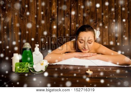 Beautiful Pretty Young Woman Laying In Spa Salon With Closed Eyes And Relaxed, Xmas Concept
