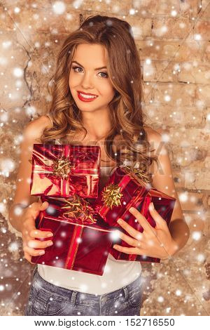Portrait Of Beautiful Young Woman Holding Presents On Xmas