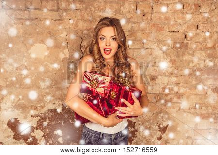 Pretty Surprised Girl Holding Presents On New Year