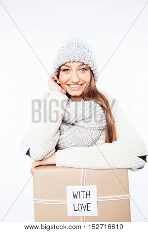 Cheerful Woman  In Warm Hat And Scarf With Package Congratulate With Xmas..