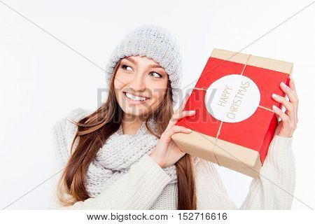 Cheerful Woman  In Warm Hat And Scarf Holding Package And Congratulate With Xmas..