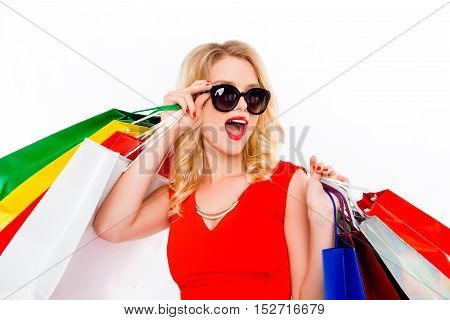 Smiling Woman In Dress And Glasses Holding Packages With Clothes