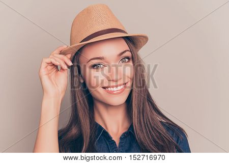 Portrait Of Pretty Girl With Beaming Smile Touching Her Hat