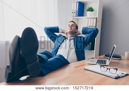 Smiling Businesswoman Relaxing In Office After Hard Working Day