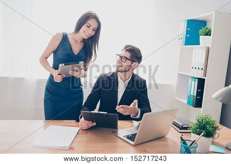 Portrait of executive businesswoman consulting with her colleague about project