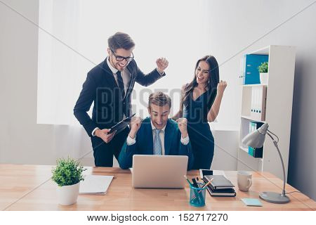 Happy Businesspeople With Raised Hands Winning Financial Competition