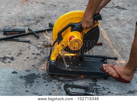 worker cutting metal by electric Grinding  machine