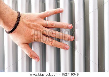 hand check heater temperature radiator closeup pipe