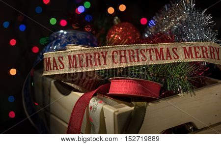 Christmas ornament and ribbon in a storage box with black background