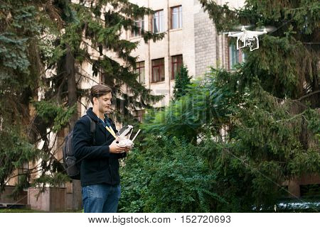 Young man with flying drone. New technology photo and video
