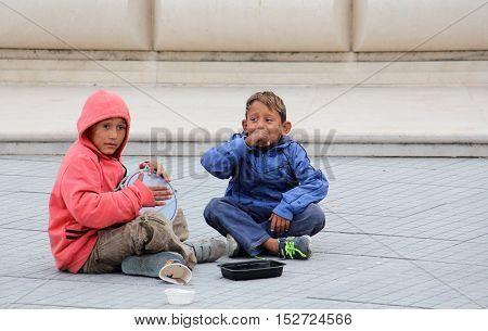SKOPJE MACEDONIA - OCTOBER 18, 2016:Roma boy singing and playing darbuka asking for money downtown of Skopjecapital of Macedonia