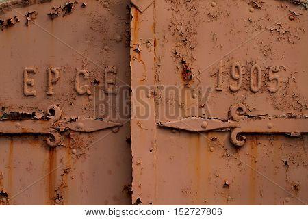 Rusty vintage iron door with exfoliating paint