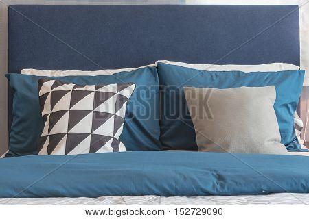 a modern blue color tone bedroom design