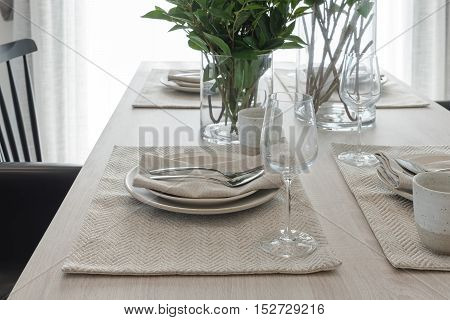 Modern Dinning Room With Black Modern Chair And Vase Of Plant