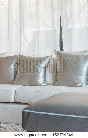 Set Of Pillows On Modern Sofa In Living Room