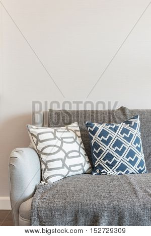 Set Of Pillows On Sofa In Modern Living Room