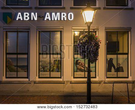 Zierikzee The Netherlands - October 5 2016: Front of an ABNAMRO bank in Zierikzee at night Zeeland The Netherlands