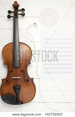 violin with music paper note and dvd disc on white wood background