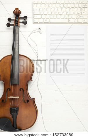 violin with music paper note and keyboard computer on white wood background