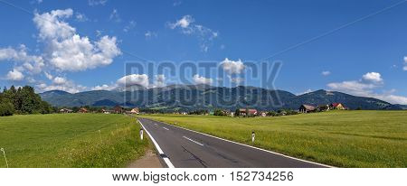panoramic landscape of fields and Alps mountains in central Styria Austria